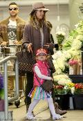 Jessica Alba's daughter, Haven, wearing our Signature Flower Hat.
